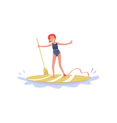 young woman standing on paddle board vector image