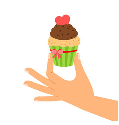 cupcake with red heart in hand vector image vector image