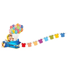 An airplane with balloons and hanging clothes vector image vector image