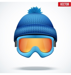 Knitted woolen blue cap with snow goggles Winter vector image