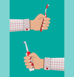 Electric and manual toothbrush in hand vector