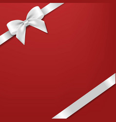 White bow and ribbon with red background vector