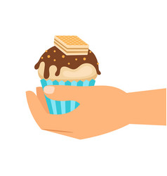 hand holding wafer cupcake vector image