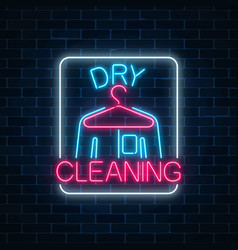 Neon dry cleaners glowing sign with hanger and vector