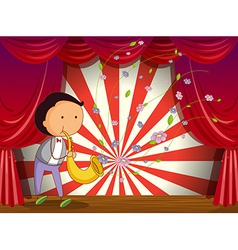 A boy playing trombone at the stage vector image