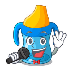 Singing cartoon baby drinking from training cup vector