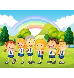 Children in uniform standing in the park vector image vector image