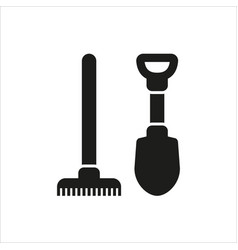 Shovel and rake icon isolated on white background vector