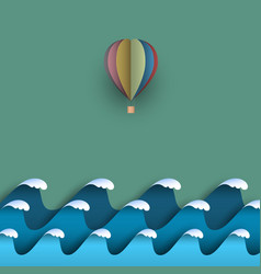 Blue origami paper waves with hot air balloon vector