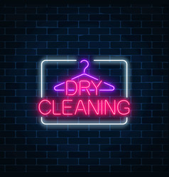 Neon dry cleaning glowing sign with hanger on a vector