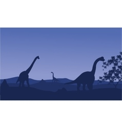 Silhouette of brachiosaurus with blue backgrounds vector image