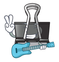 With guitar cartoon binder clip above wooden table vector
