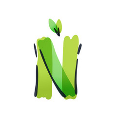 N letter ecology logo with green leaves vector