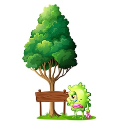 A green monster crying beside the empty wooden vector image