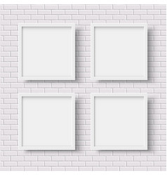 Four white square empty frames on white brick wall vector