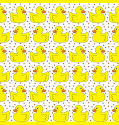 Seamless yellow ducks pattern vector