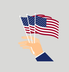 hand holding american flags vector image