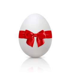 white egg with red bow vector image