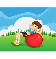 A young lady exercising with a bouncing ball in vector