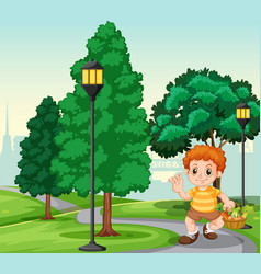 a boy with basket in park vector image