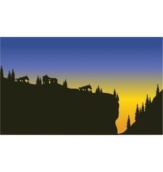 Silhouette of trees on the cliff vector image
