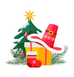 santa hat on giftbox near decorated christmas tree vector image