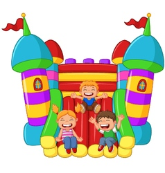 cartoon little kid playing slide on the inflatable vector image
