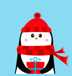 penguin holding gift box present red hat and vector image