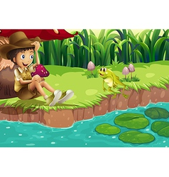 A boy and a frog at the riverbank vector image
