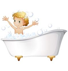 A young boy taking bath at the bathtub vector