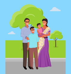 indian family wearing traditional clothes in park vector image