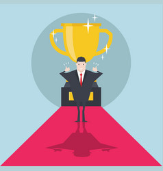 businessman standing in front of a golden trophy vector image