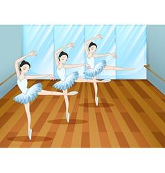 Three ballet dancers inside the studio vector