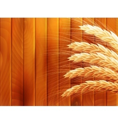 Wheat on wooden autumn background EPS 10 vector