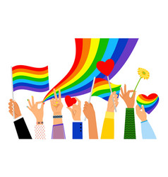 Hand holding pride flag vector