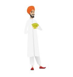 Happy hindu businessman holding money vector