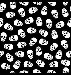 Seamless pattern white skulls on a black backgroun vector