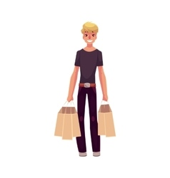 Smiling young man standing with shopping bags vector image