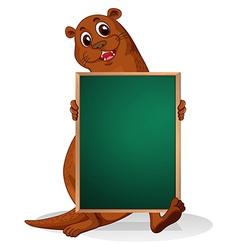 A sealion holding an empty blackboard vector