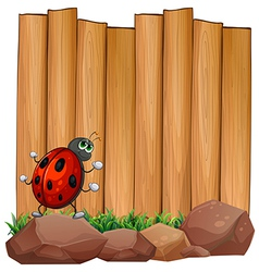 A bug on a rock near the empty signboard vector image vector image