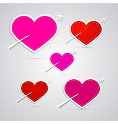 paper red pink hearts pierced with arrows vector image vector image
