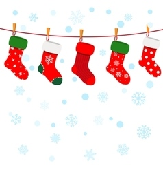 Christmas background with snowflakes and socks vector