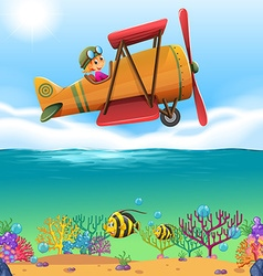 Girl flying airplane over the ocean vector