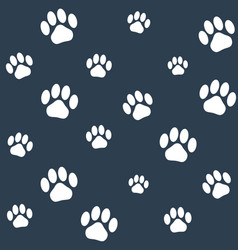 Seamless monochrome cat paws pattern vector