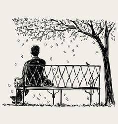 Lonely man sits on the park bench vector