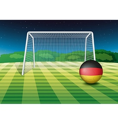 A soccer ball near the net with the flag of vector image