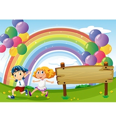 An empty board and two kids playing below the vector image vector image