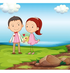 A couple at the riverbank near the rocks vector image