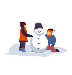 boys building snowman with bucket on top vector image