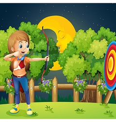 A girl playing archery vector